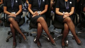 Prospective flight attendants listen to their instructor during an etiquette training course at Indigo Airlines' Ifly training centre in Gurgaon
